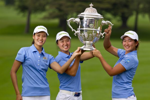 Australia team members Shelly Shin (left), Minjee Lee and Su Oh pose for photos with the trophy following the final round at the 2014 Espirito Santo Trophy at Karuizawa 72 Golf East in Karuizawa, Japan on Saturday, Sept. 6, 2014.  (Copyright USGA/Steven Gibbons)