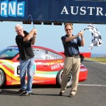 Fergus Cameron (Left), Managing Director of Phillip Island Grand Prix Circuit, tees it up with Phillip Island Golf Club Professional Marcus Liberman on the Grand Prix track at Phillip Island at the launch of the 2011 Linfox Pro Am