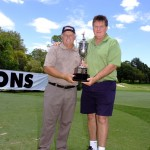 Queensland PGA tournament chairman Peter McWhinney presents Peter Senior with the Charles Bonham Trophy