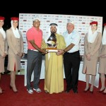 Mohamed Juma Buamaim, vice chairman and CEO of golf in DUBAi, presenting the winner's trophy to Tiger Woods and Mark O'Meara