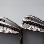 Rear view of a Titleist AP2 iron (Genuine on left)
