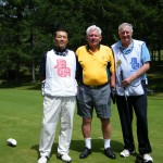 Blind golfer David Blyth (centre) with his caddie Gary McInnes (right), and scorer Toshitaka Kadokawa (left) on the Minakami Kogen golf course in Japan.