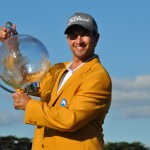Adam Scott all smiles with his second Talisker Masters trophy and jacket