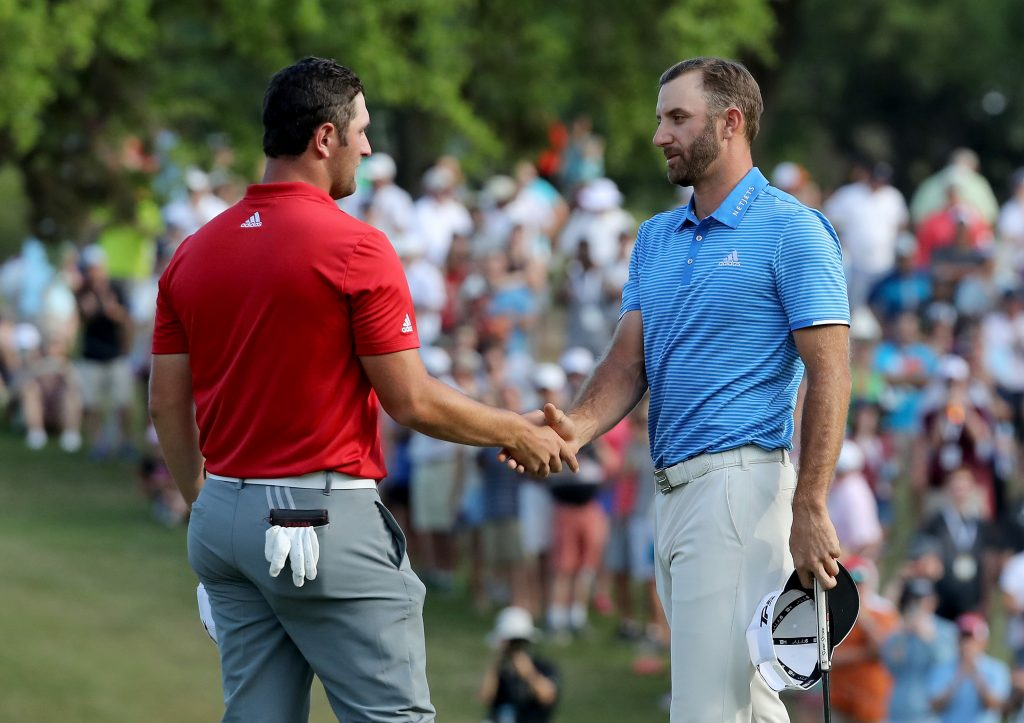 Dustin Johnson of the United States shakes hands with John Rahm of Spain (l) after hiw one hole win during the final of the 2017 Dell Match Play at Austin Country Club on March 26, 2017 in Austin, Texas. (Photo by David Cannon/Getty Images)