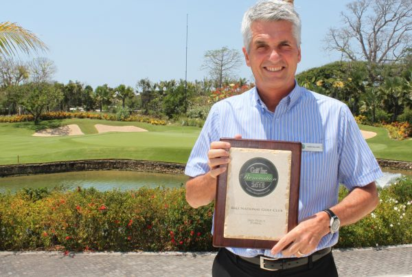 Bali National Golf Club general manager Mark Holland shows off the 2015 Renovation of the Year Award from Golf Inc.