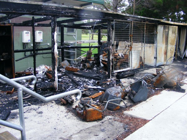 The smouldering ruins of Wallangarra Golf Club's machinery shed