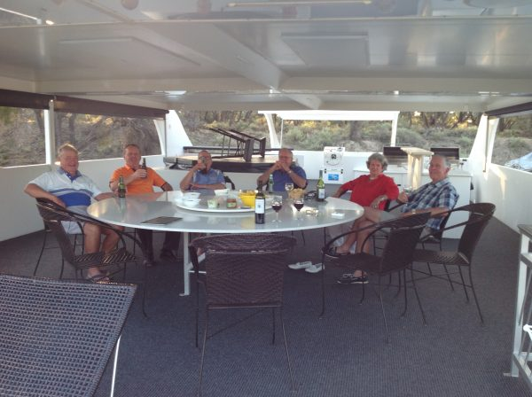 Guests enjoy drinks on the upper deck during a Murray River Magic cruise