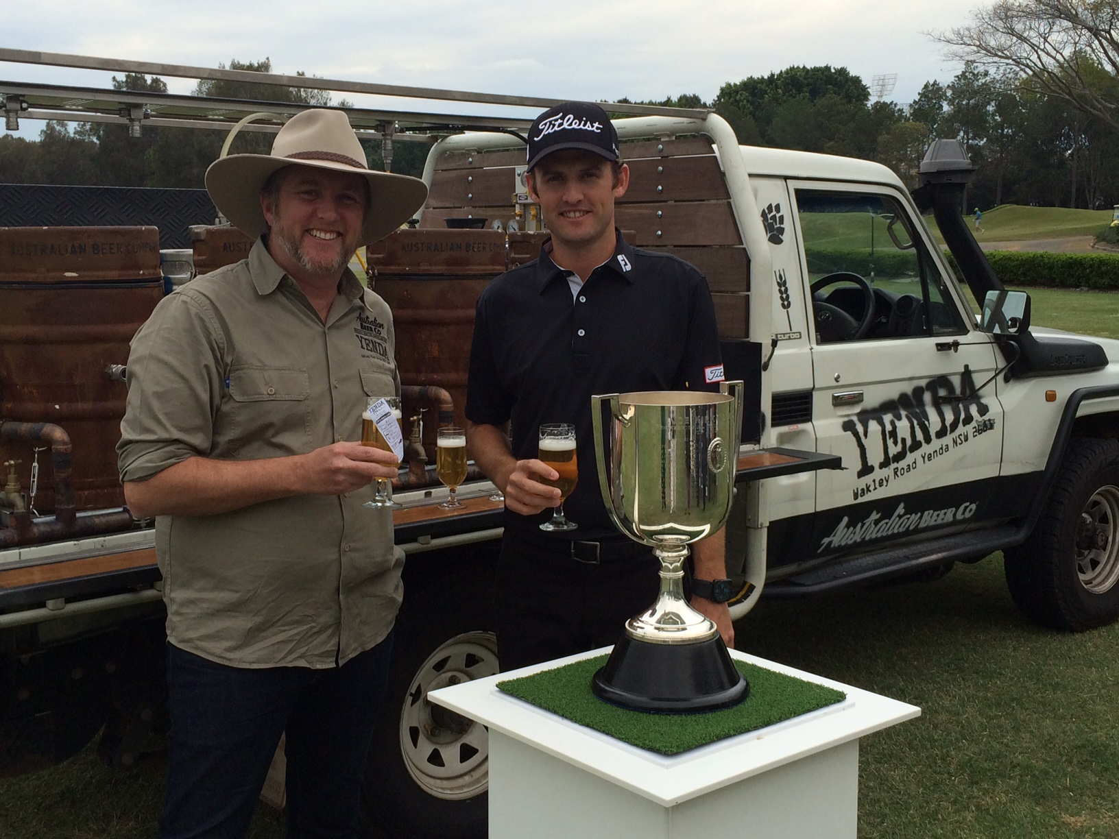 Sam Johnston from Australian Beer Company with Tour Pro Michael Sim and 'Andy the Landie' Yenda's mobile bar. (1)